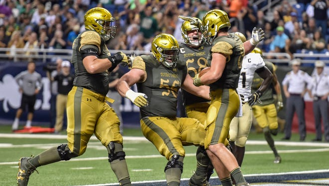 Nov 12, 2016; San Antonio, TX, USA; Notre Dame Fighting Irish tight end Durham Smythe (80) celebrates with offensive lineman Quenton Nelson (56) and offensive lineman Mike McGlinchey (68) after a touchdown in the second quarter against the Army Black Knights at the Alamodome.