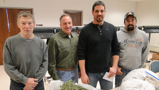 Top entries in the Dodge County Forage Council's forage contest on Friday at Juneau include, from left, Ron Wiskerschen, Hartford, winning baled hay; Peter McFarland, Watertown, winning haylage; Luke Miller, Oconomowoc, winning baleage; and Chris Conley, Neosho, winning corn silage.