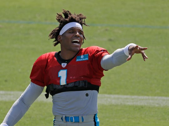 Carolina Panthers' Cam Newton jokes with the crowd during practice at the NFL football team's training camp in Spartanburg, S.C., Saturday, July 27, 2019. (AP Photo/Chuck Burton)