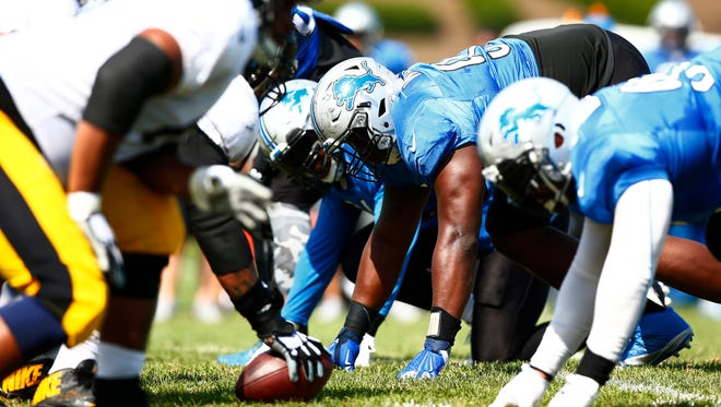 Members of the Detroit Lions and the Pittsburgh Steelers stand on the line of scrimmage during an NFL football scrimmage at the Steelers' training camp in Latrobe, Pa., on Tuesday, Aug. 9, 2016.