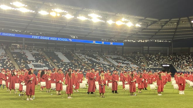 Graduates sing the alma mater at the end of Friday night's Fort Osage High School graduation.