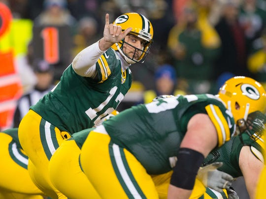 Aaron Rodgers calls out a play during Monday's game