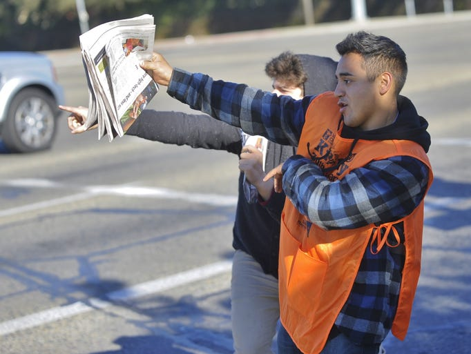 Redwood High School ASB students sell Kids Day papers