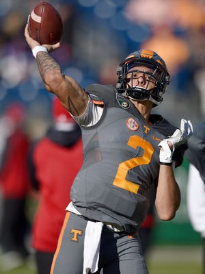 Tennessee quarterback Jarrett Guarantano  warms up before the Franklin American Mortgage Music City Bowl on Dec. 30, 2016,  at Nissan Stadium in Nashville.