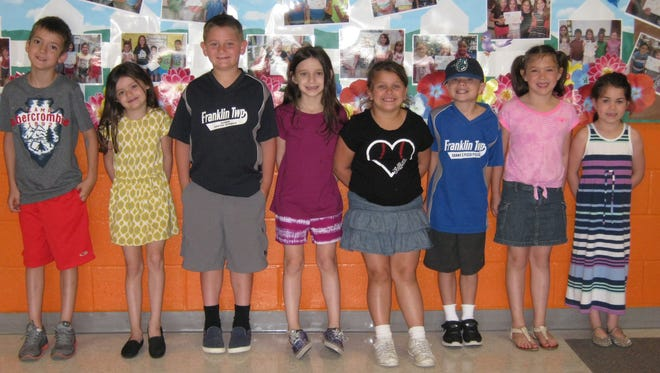 First-graders named Students of the Month for May at Janvier School in Franklin are: (from left) Joshua Emery, Jaelyn Rudderow, Blake Starr, Allison Roberson, Jullianna Carroll, Logan Kinsella, Mackenzie Brown and Neko Faust.