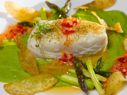 Alaskan halibut was served with pea puree, asparagus,