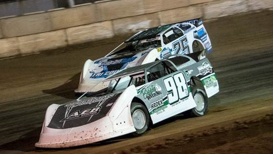 61-year-old Tom Naeyaert (98) ducks underneath second year late model driver Jared Siefert (25) of Luxemburg in Saturday Night action at Shawano Speedway.