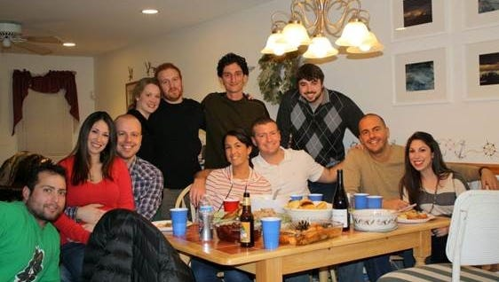Eric Allen and his friends have been celebrating Friendsgiving for seven years. Here, they are shown at one of their first Friendsgivings in 2011.