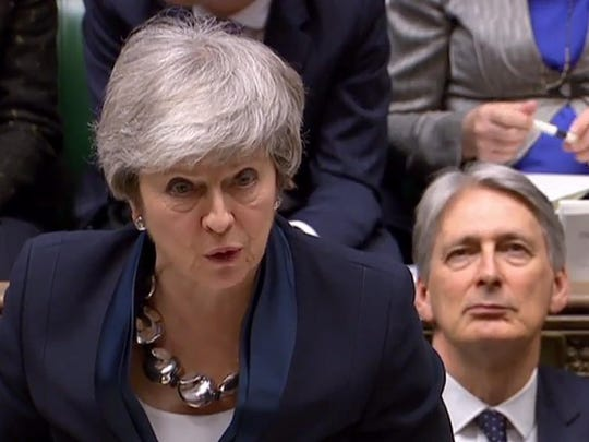 A video grab from footage broadcast by the UK Parliament's Parliamentary Recording Unit (PRU) Britain's Prime Minister Theresa May as she makes a statement to the House of Commons in London on Feb. 26, 2019.