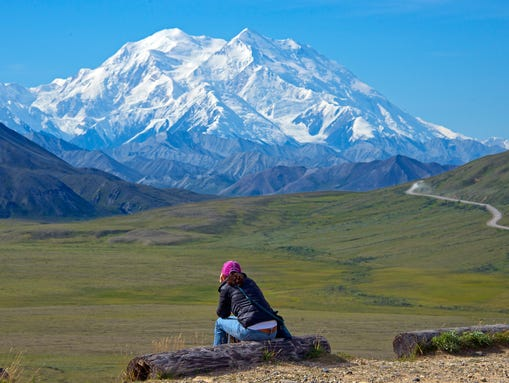 A woman gazes at Mount McKinley in Denali National