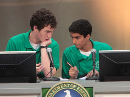 The North Carolina School of Science and Mathematics team members - Bryce Taylor, Christian Johnson, Akhil Jariwala and Patrick Yang - work on the answer to a question in the final round of the 2010 National Science Bowl competition in Washington, DC.