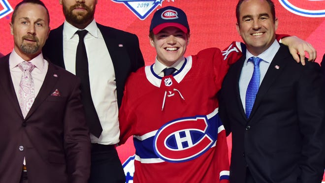 Stevens Point native Cole Caufield, a first-round draft pick of the Montreal Canadiens in 2019, signed a three-year contract with the Canadiens on Saturday.