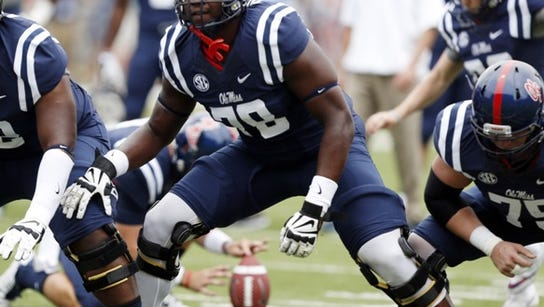 Mississippi offensive linesman Laremy Tunsil (78) steps