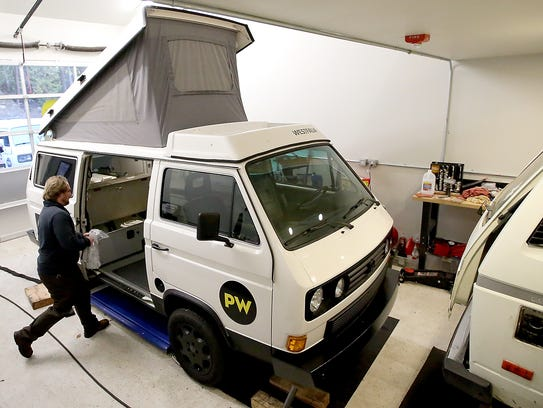 PacWesty's Nolan Donahue moves through the shop as he packs up a Volkswagen Westfalia camper van named Burt while getting it prepared for pickup by renters on Tuesday, November 21, 2017.