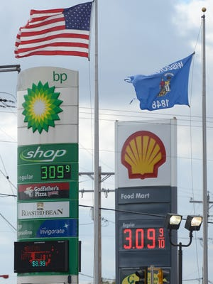 Gas stations at South Ridge Road and Cormier Road in Ashwaubenon show gas prices nearing $3 a gallon on Tuesday.