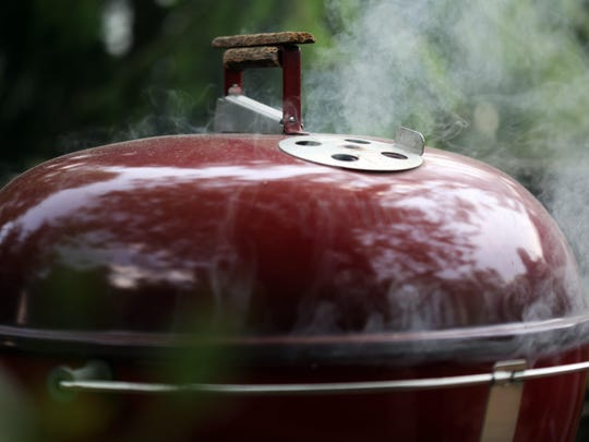 If using charcoal and the color of the smoke is gray or turning toward black, move the coals around and adjust the vents so the fire gets more air.