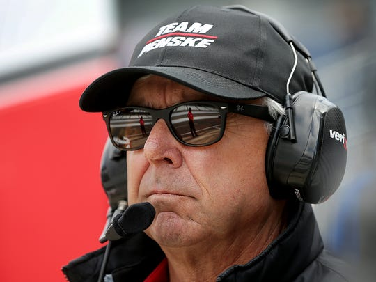 Team Penske's Rick Mears watches from the pit box during
