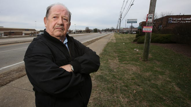 Okolona resident Bill Sizemore stands next to a city bus stop on the Outer Loop near the Jefferson Mall.  He is upset that there are not many covered bus stops with benches in the area.   He is also disappointed with the results of the city/county merger which he says have neglected his area.Jan. 31, 2017