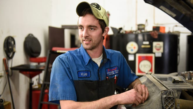 Kyle Bednar talks about his experiences  while working Friday, Dec. 18, at Brandl Motors in Little Falls.