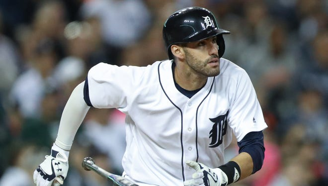 Detroit Tigers slugger J.D. Martinez hits a two-run homer against the Cleveland Indians on Sept. 26, 2016, at Comerica Park in Detroit.