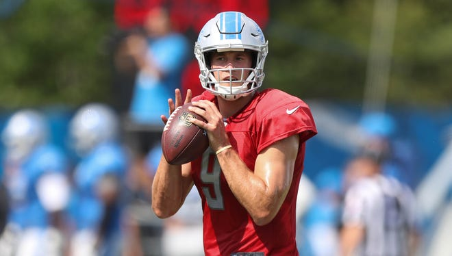 Lions quarterback Matthew Stafford goes through passing drills Tuesday, August 1, 2017 in Allen Park.