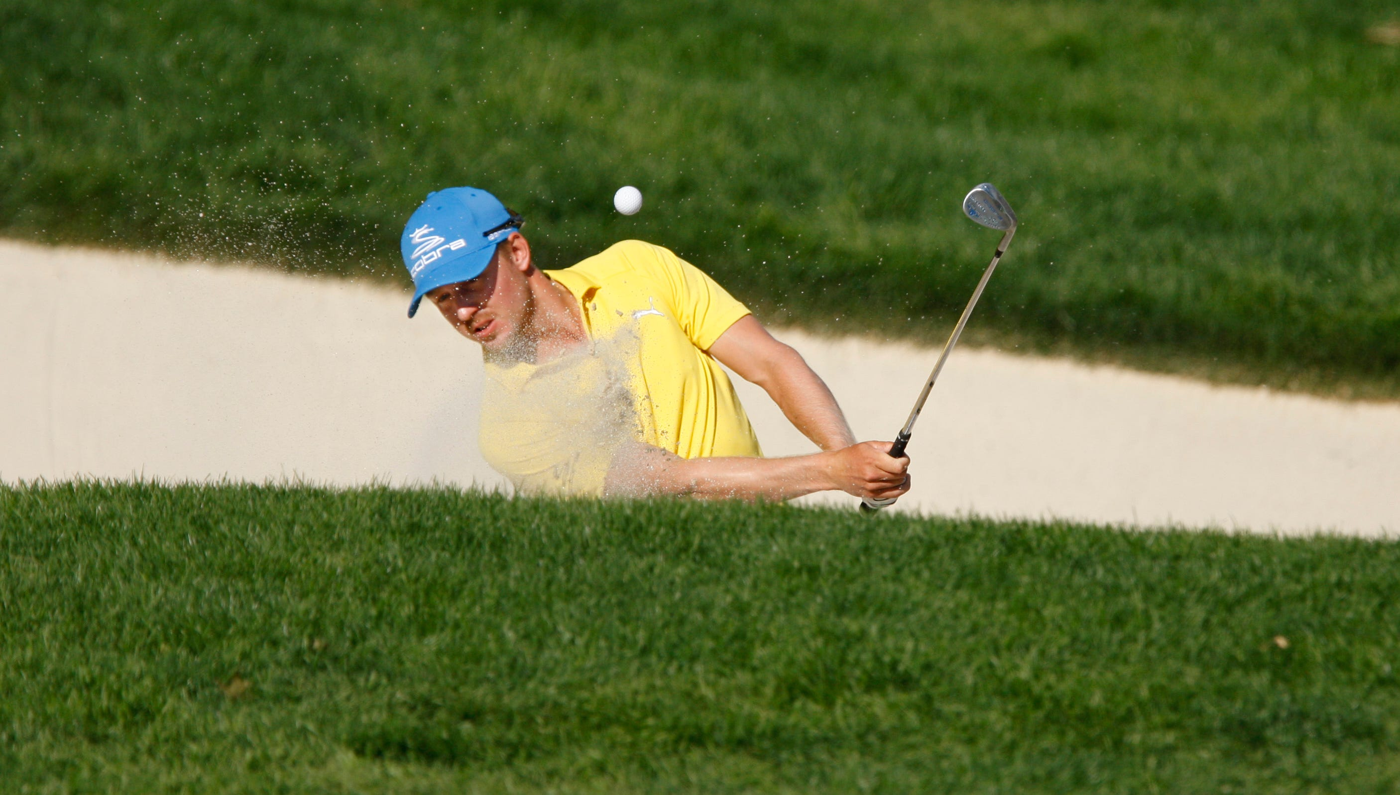 Jonas Blixt hits out of a bunker on the 17th during the final round of the 95th PGA Championship Sunday, Aug. 11, 2013 at Oak Hill Country Club in Pittsford.