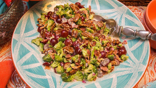 Broccoli, grapes, bacon and nuts team up in this salad.