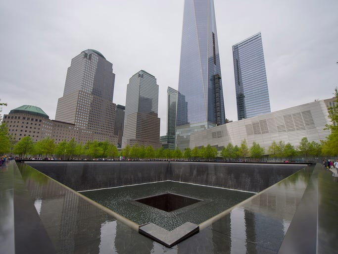 People view the South Memorial Pool next to the National September 11 Memorial Museum and One World Trade Center at Ground Zero on May 14 in New York City.
