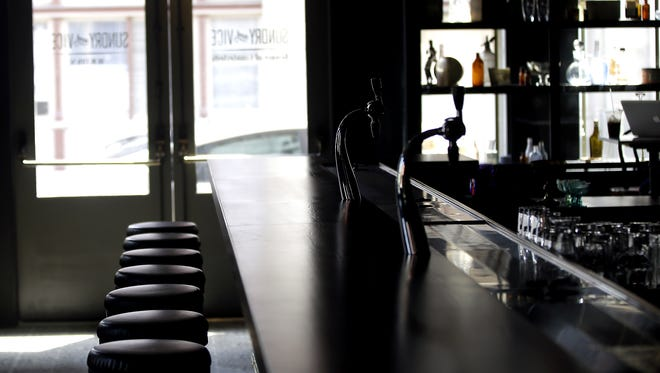 Bar stools in Sundry and Vice opening in OTR.