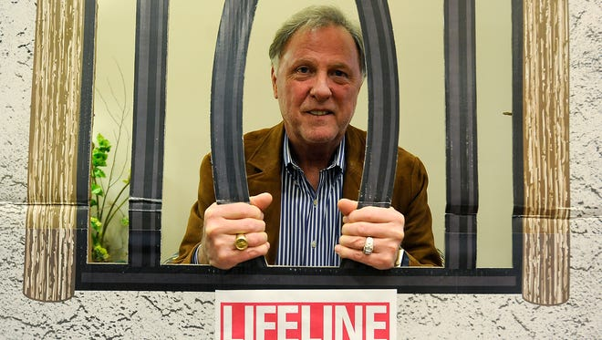 Madison County Mayor Jimmy Harris poses in a 'jail' at Lifeline Blood Services in Jackson, Tenn., on Thursday, Dec. 29, 2016.
