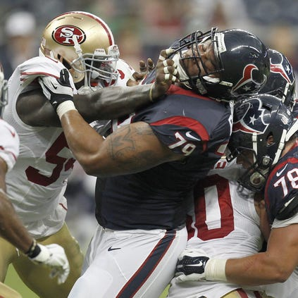 Ahmad Brooks #55 of the San Francisco 49ers hits Brandon Brooks #79 of the Houston Texans in the first quarter in a pre-season NFL game on August 28, 2014 at NRG Stadium in Houston, Texas.