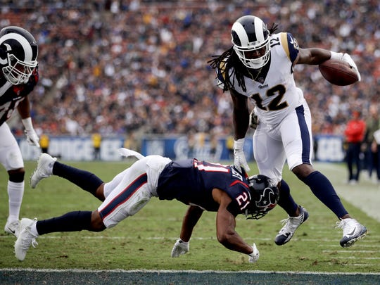 Los Angeles Rams wide receiver Sammy Watkins, right, scores past Houston Texans strong safety Marcus Gilchrist during the second half of an NFL football game Sunday, Nov. 12, 2017, in Los Angeles. (AP Photo/Jae C. Hong)