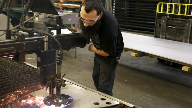 Pat Zorn working with a plasma cutter at Leo J. Roth Corp. in Webster.
