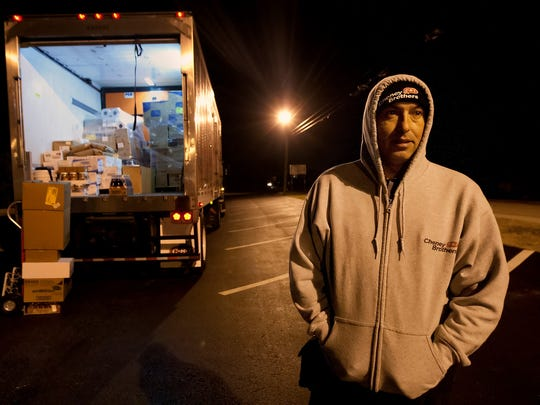 "Carlos Duarte waits to deliver frozen foods to a restaurant on Bonita Beach Road early Friday (2/20/15) morning. ""It is cold out here but it is really cold in the truck,"" said Duarte. How cold is it in the truck? -13 degrees."
