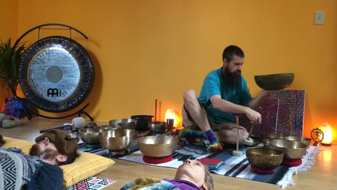 "Greg Burns, a certified sound practitioner with Metta Vibrations, leads a New Year's Day ""sound meditation"" at his studio in Staunton, Va., on Jan. 1, 2017."