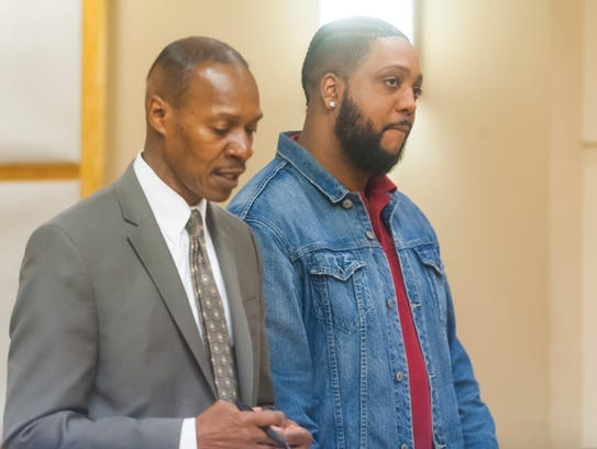 Terell Hubbard (right), convicted of killing his infant daughter in 2008, listens as his lawyer, Wayne Powell (left), addresses the judge during his sentencing hearing in the Cumberland County Superrior Court on Monday.