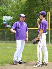 Plymouth Christian Academy coach Joe Bottorff (left) talks to a pitcher in this undated file photo. Bottorff coordinated efforts to help the Onaway baseball team find a place to get some games in this weekend. The Cardinals' home field was blanketed in two feet of snow recently.