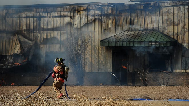 Sioux Falls Fire and Rescue respond to a fire at Linda Avenue and Monty Street in Tea on Tuesday, Feb. 24, 2015.