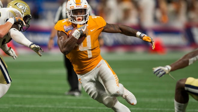 Tennessee running back John Kelly (4) runs with the ball during the Chick-fil-A Kickoff Game at the Mercedes-Benz Stadium in Atlanta on Monday, Sept. 4, 2017.