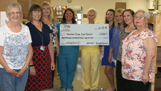 As part of National Nurses Week and National Hospital Week, nurses and other staff of Baxter Regional Medical Center collected $3,600 to donate to the Mountain Home Food Basket.Pictured are: (from left) Kaye Owens, food drive coordinator; Kim Beavers, human resource coordinator for BRMC; Sheila Wilson, human resource employment coordinator for BRMC; Barb Dyson, director of endoscopic services at BRMC; Bonnie Ratzel, president of the Food Basket; Frankie Tilley, nursing administrative assistant at BRMC; Sonyia Gower, nursing administrative assistant at BRMC; Natalie Amato, senior human resource manager at BRMC; and Debra Barreda, food buyer for the Food Basket.