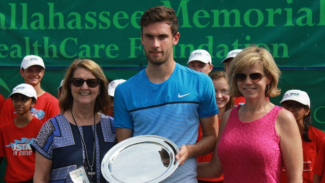 (From left) Tallahassee Challenger tournament director Karen Vogter poses with champion Quentin Halys and tournament hospitality director Lori Willyoung on Saturday.