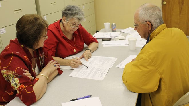 Baxter County Election Commissioners (from left) Cheryl Munson Beall, Lois Smith and Bob Bodenhamer work toward counting absentee ballots Tuesday afternoon at Election Headquarters.