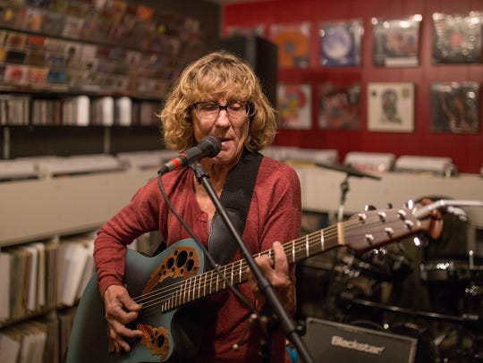Local folk artist Alison Reynolds performs at Eyeconik Records & Apparel on Dec. 1 during a free live music event.