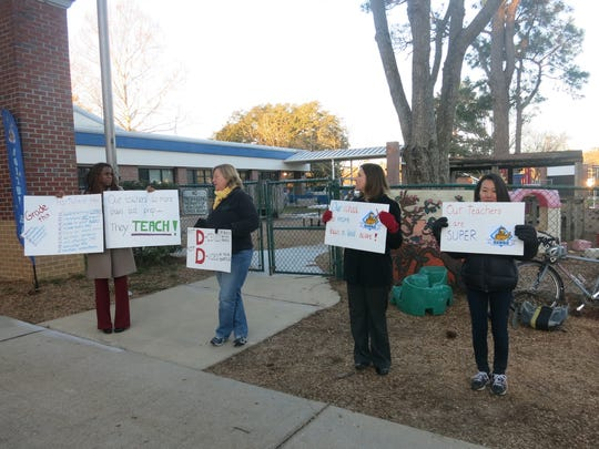 Parents rallied to protest school grades and show support for teachers outside of Hartsfield Elementary last month.