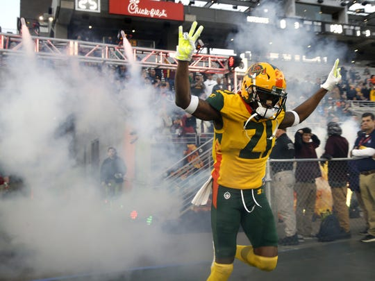 Hotshots' Robert Nelson comes onto the field to play