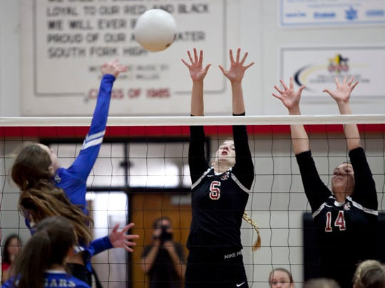 A Barron Collier High School volleyball player goes for the kill against South Fork in the Class 7A state semifinal on Saturday, Nov. 5, 2016, in Tropical Farms.