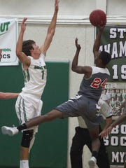 Fort Myers' Connor Jenkins plays defense during a game against Monignor Pace at Fort Myers High School on Tuesday.