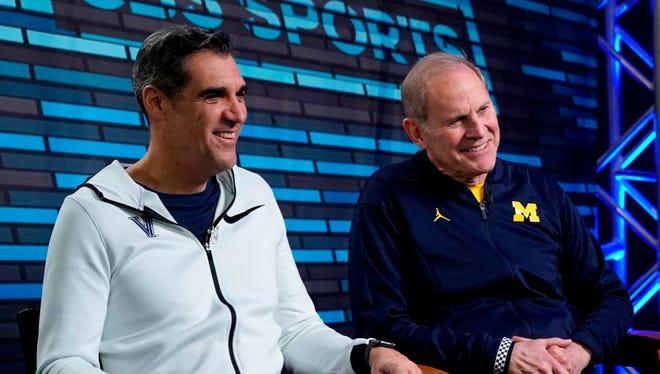 Villanova head coach Jay Wright and Michigan head coach John Beilein answer questions during an interview Sunday.