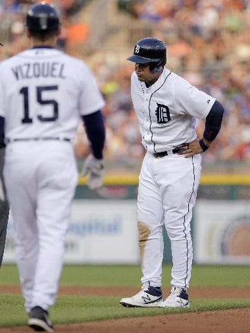 Detroit Tigers' Miguel Cabrera is approached by first