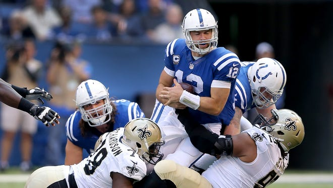 Indianapolis Colts quarterback Andrew Luck (12) is sacked by New Orleans Saints defensive tackle John Jenkins (92),right, and defensive end Bobby Richardson (78),left, as tackle Anthony Castonzo (74) looks on during the second half of an NFL football game Sunday, Oct. 25, 2015, at Lucas Oil Stadium.